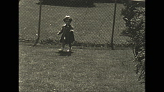 Vintage 16mm film, 1935, people, little sisters playing together Stock Footage