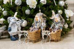 Two Elf toys in the sleigh with reindeer and snowman in New Year's holiday un - stock photo