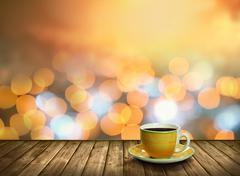 Stock Photo of Tea cup on the wood in the bokeh city light