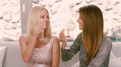 Smiling women drinking champagne glass Stock Footage