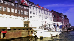 Ancient canal with rubber tires in Copenhagen Stock Footage