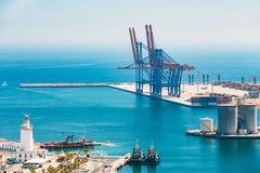 Aerial view of a cargo dock, commercial port in Malaga, Spain Stock Photos