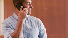 Smiling man having a phone call Stock Footage