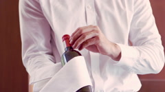 Mid section of waiter proposing red wine Stock Footage