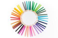 Sun made of color pencils as logo. Isolated Stock Photos