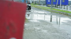 A man riding a quad bike through the puddles Stock Footage