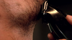 Close up of man shaving with electric razor Stock Footage
