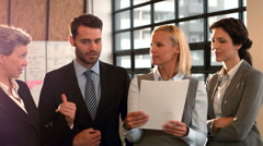 Business people talking at holding documents Stock Footage