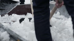 Young people throw shovels snow from the van. Close-up - stock footage
