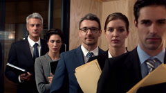 Serious lawyers looking at the camera - stock footage