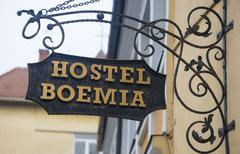 "DECEMBER 8, 2015 - BRASOV: the ""Hostel Boemia"" sign on a building in Brasov - stock photo"