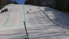Sunny winter day at Ontario ski resort downhill dummy race day Stock Footage