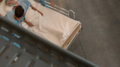 Medical team carrying a patient to intensive care unit Stock Footage