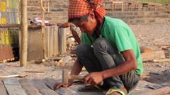 People hammering nails. Assam. India - stock footage