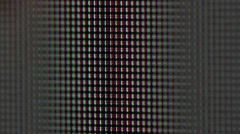 Pixels of the liquid crystal monitor, closeup, abstract background timelaps Stock Footage