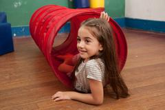 Portrait of a little girl playing in kindergarten Stock Photos