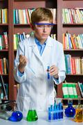 Cute boy doing biochemistry research in chemistry class Stock Photos