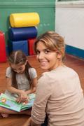 Kids reading a book in a kindergarten class - stock photo