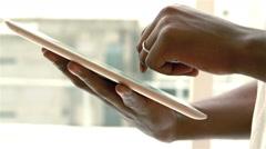 Feminine hands using tablet Stock Footage
