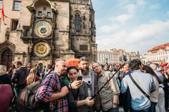 Group of tourists taking pictures against background of sights - - stock photo