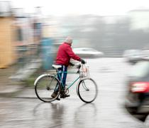 Cyclist on the city roadway Stock Photos