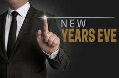 new years eve touchscreen operated by businessman concept - stock photo