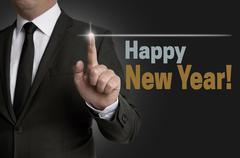 Stock Photo of Happy New year touchscreen operated by businessman concept