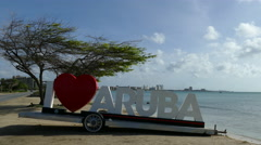 I love Aruba sign with skyline of hotels at the background - stock footage