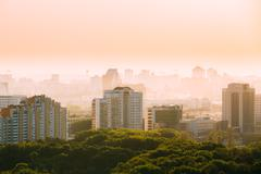 Cityscape in haze of Minsk, Belarus. Summer season, sunset Stock Photos