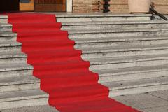 long red carpet for the catwalk of celebrities - stock photo