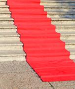 red carpet for the catwalk of celebrities along the staircase - stock photo