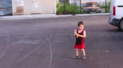 Cute little boy playing with boomerang in summer evening Stock Footage