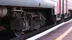 Close-up of passenger train wheel passes platform on summer day Stock Footage