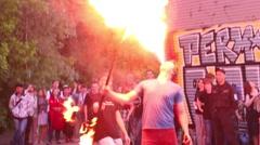 Twice spew fire. Open rehearsal of fire-eaters Stock Footage