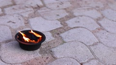 Close-up of burner fire is on ground paved with tiles Stock Footage