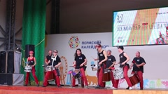 Performance of nine drummers on open air stage - stock footage