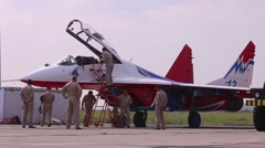Attendants Mig 29 fighter on airshow Wings of Parma Stock Footage