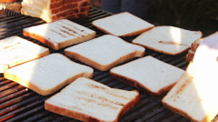 Bread for toast prepared on the grill Stock Footage