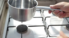 Lighting up the stove Stock Footage