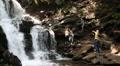 People near beautiful waterfall in Carpathian Mountains, Ukraine HD Footage