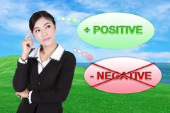 Business woman thinking about positive with green grass field and sea - stock photo
