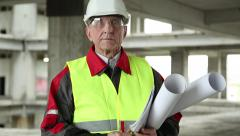 Chief architect at construction site Stock Footage