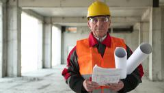 General foreman with building drawings at project site Stock Footage