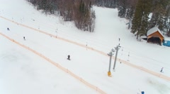Skiers and snowboarders on the ski elevator top view Stock Footage