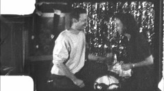 Man Proposing Marriage to Woman Christmas 1960s Vintage Film Home Movie 8879 Stock Footage