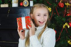 Happy girl holding gifts. Waiting for Christmas. Celebration. New Year - stock photo