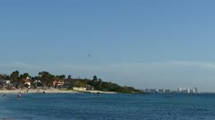Stock Video Footage of Arashi Beach on Aruba with hotel skyline at the background