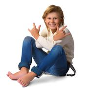 Cute blonde boy or teenager in full length casual style blue jeans posing Stock Photos
