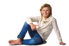 Cute blonde boy or teenager in full length casual style blue jeans posing and Stock Photos