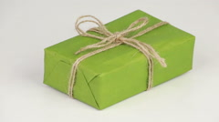 Box covered with green wrapping paper Stock Footage